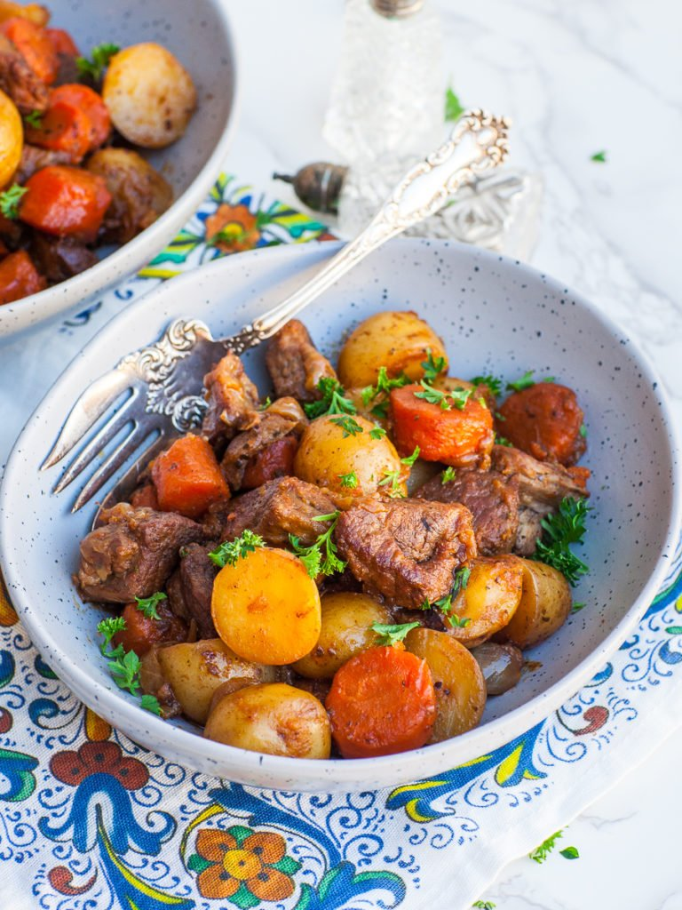 roasted leg of lamb with potatoes and carrots