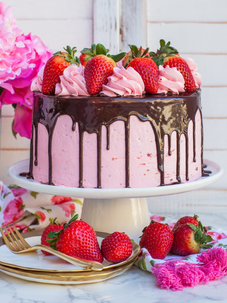 Neapolitan cake with strawberry buttercream, strawberries and chocolate ganache