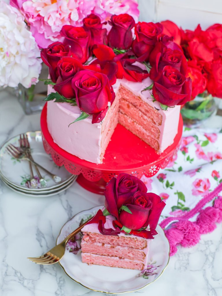 elegant rose cake with rose buttercream and rose marmalade and red roses