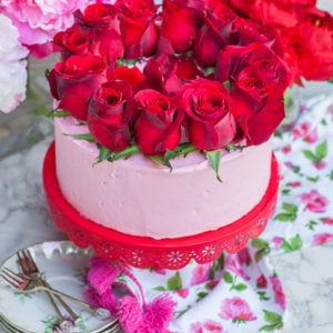 rose water cake with rose buttercream and red roses; Valentine's Day cake