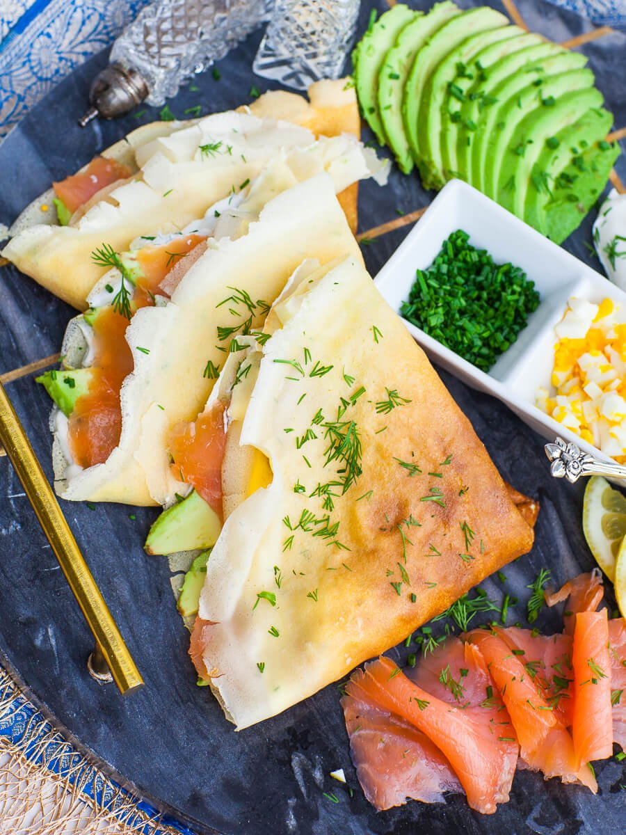 smoked salmon stuffed savory crepes for breakfast or brunch; with avocado and dill
