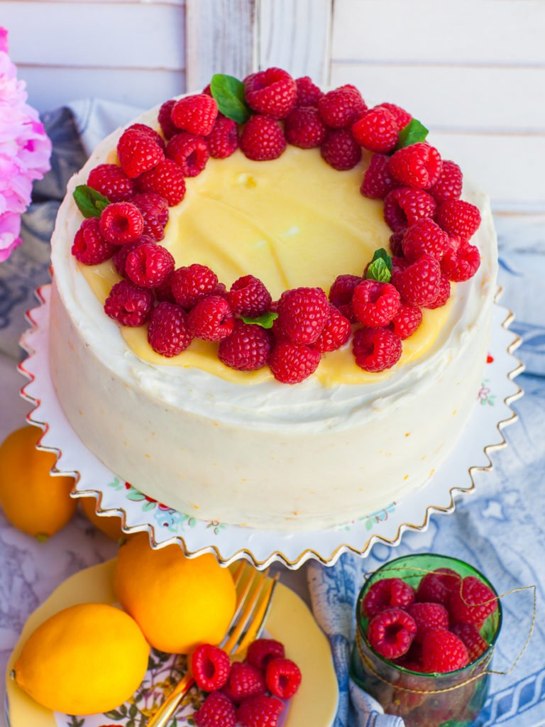 raspberry lemon cake with homemade lemon curd on floral cake stand