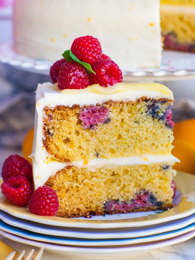 slice of raspberry lemon cake with lemon curd and berries