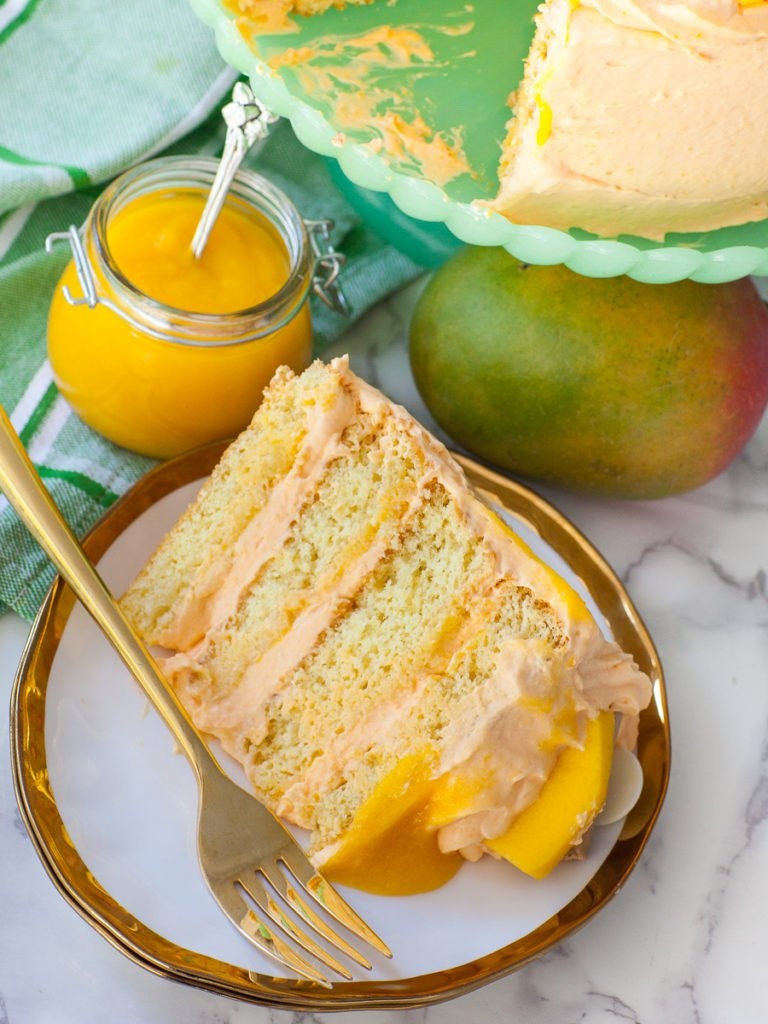 slice of mango sponge cake with mango whipped cream frosting