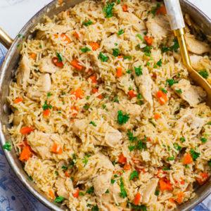 ukrainian chicken rice or chicken plov in copper pan