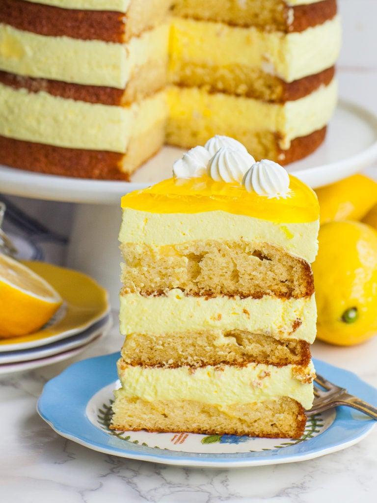 slice of lemon mousse cake with whipped cream