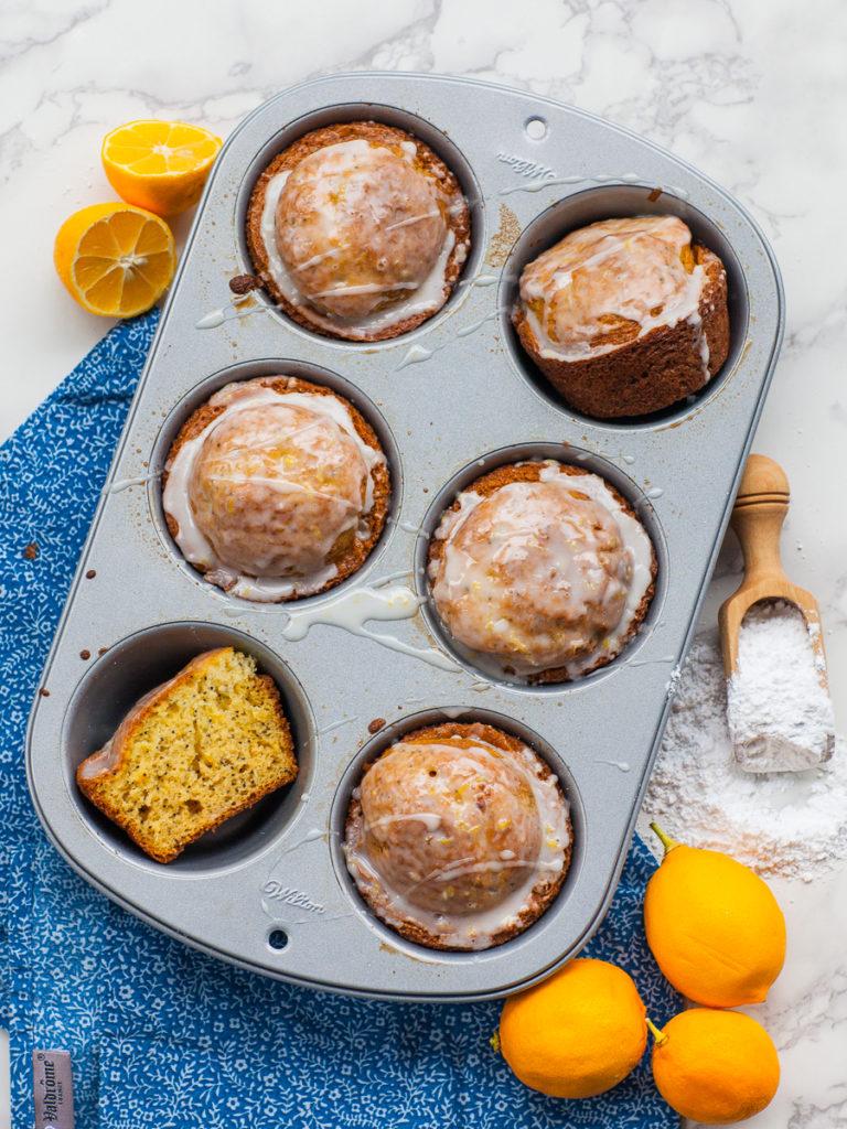 glazed poppy seed lemon muffins in muffin tin