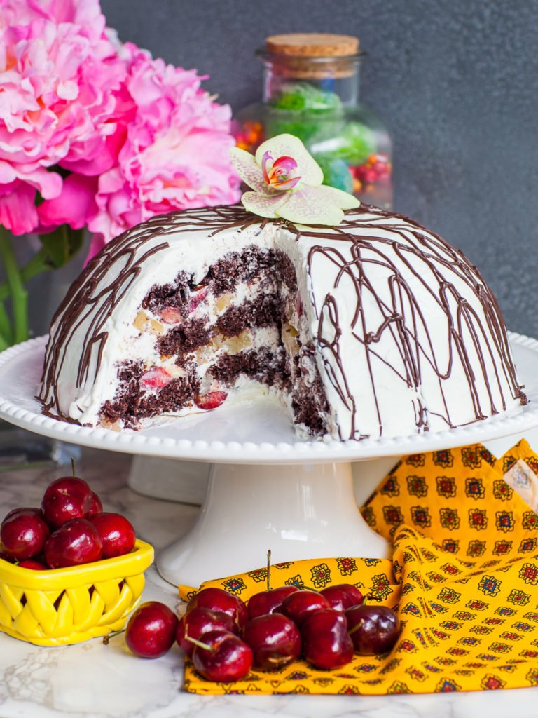 chocolate cherry cake with pineapple and whipped cream