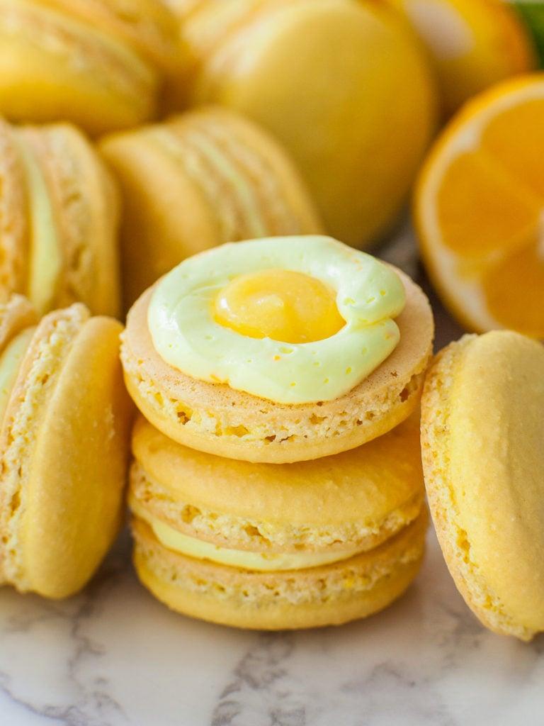 lemon macarons with lemon buttercream filling and homemade lemon curd