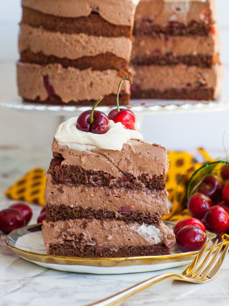 chocolate cake slice with fresh cherries and chocolate mousse