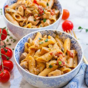 creamy sun-dried tomato and chicken pasta in small bowls