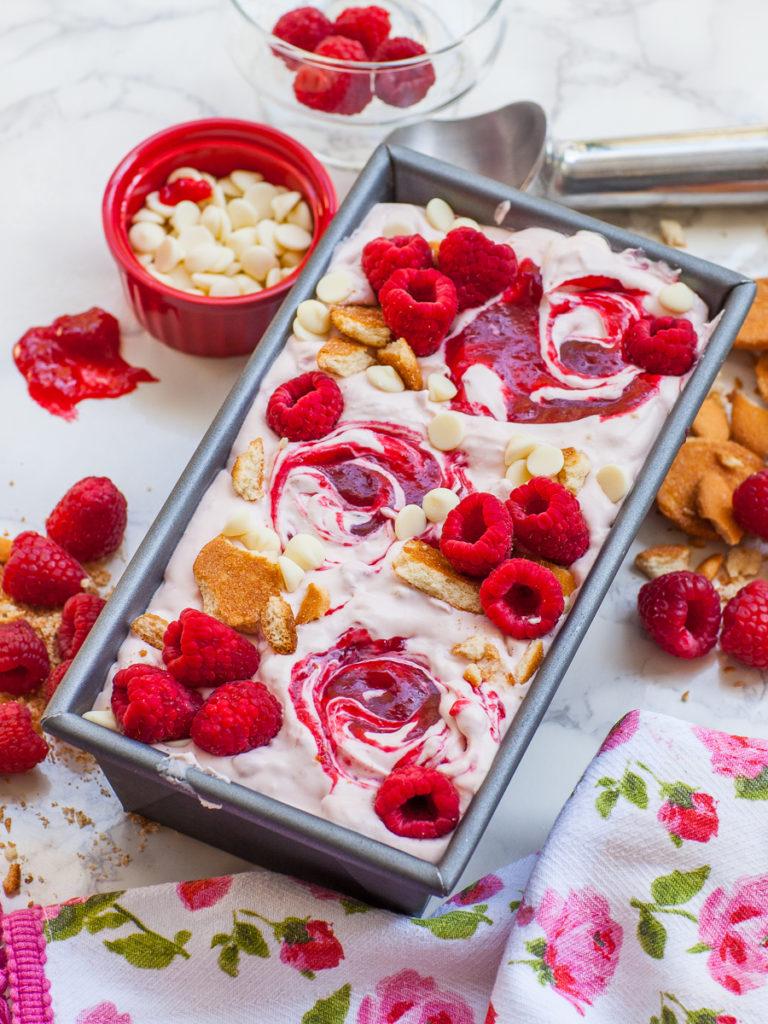 no-churn raspberry ice cream with raspberry sauce, white chocolate and vanilla wafers