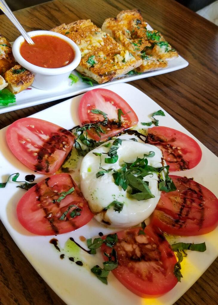 tomato and mozzarella appetizer with garlic bread