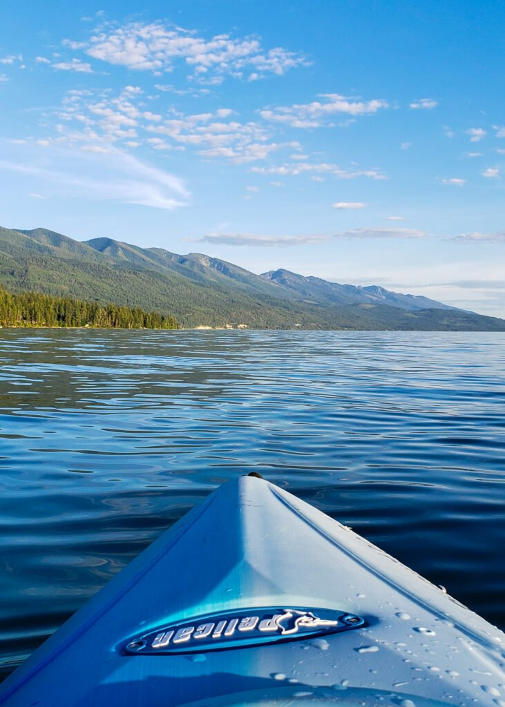 kayaking on Flathead Lake in Montana with a view of Rocky mountains