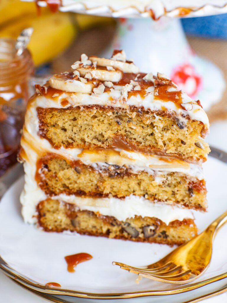 slice of Banoffee Cake with bananas and caramel and pecans