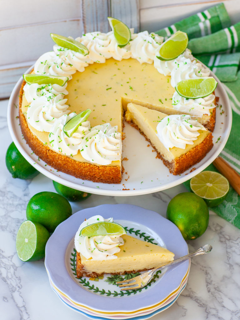 coconut key lime pie sliced with lime wedges