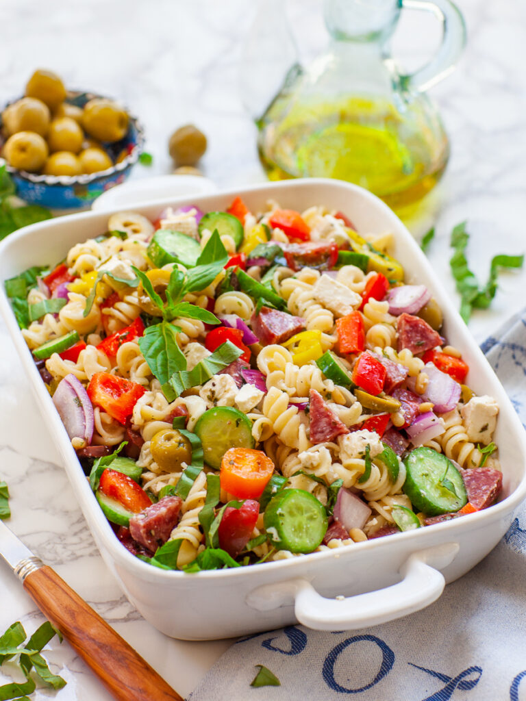 pasta salad recipe with lemon dressing, veggies, cheese, salami and olives