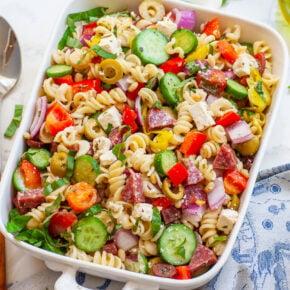 Italian pasta salad with basil, veggies, cheese and salami, with lemon dressing