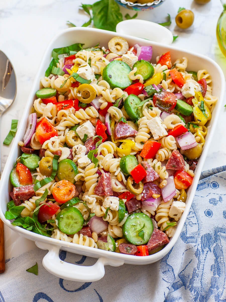 Italian pasta salad with basil, veggies, cheese and salami, with lemon dressing