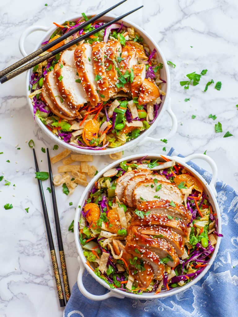 Asian chicken salad with sesame dressing, red cabbage and mandarins