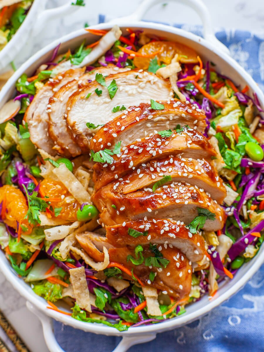 Asian chicken salad topped with teriyaki chicken breast