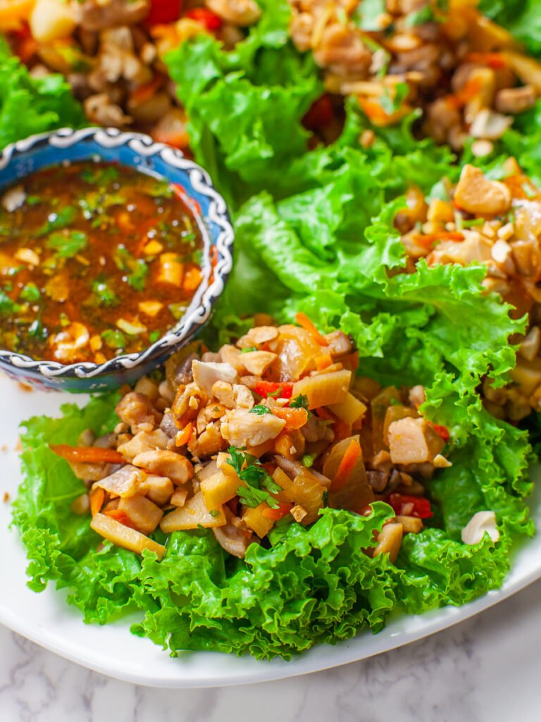 Asian chicken lettuce wrap with peanut sauce and water chestnuts