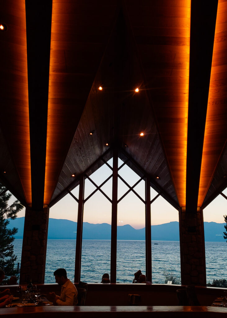 view of Lake Tahoe and mountains from The Restaurant at Edgewood Tahoe