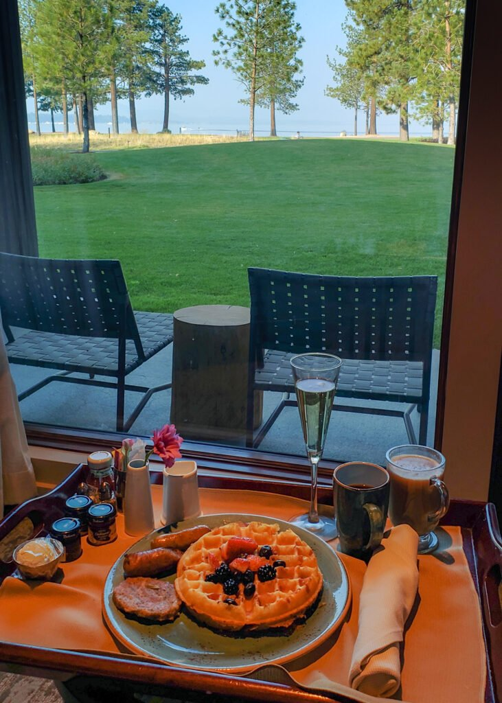 in-room dining service waffle breakfast at Edgewood Tahoe with lake views