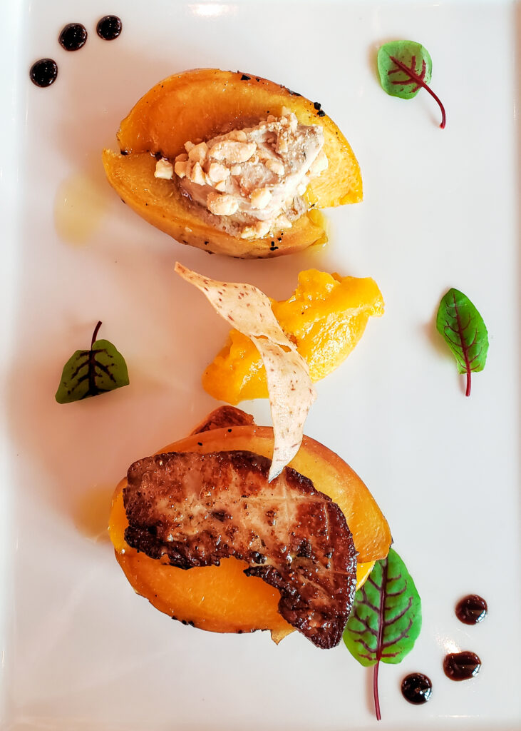 foie gras prepared two ways with grilled peaches, peach puree and garnishes
