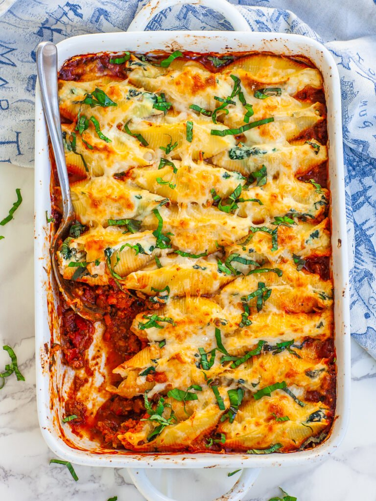 casserole with stuffed pasta shells with cheese and bolognese sauce