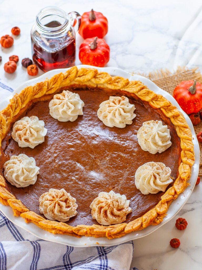 bourbon maple pumpkin pie with butter pie crust and whipped cream