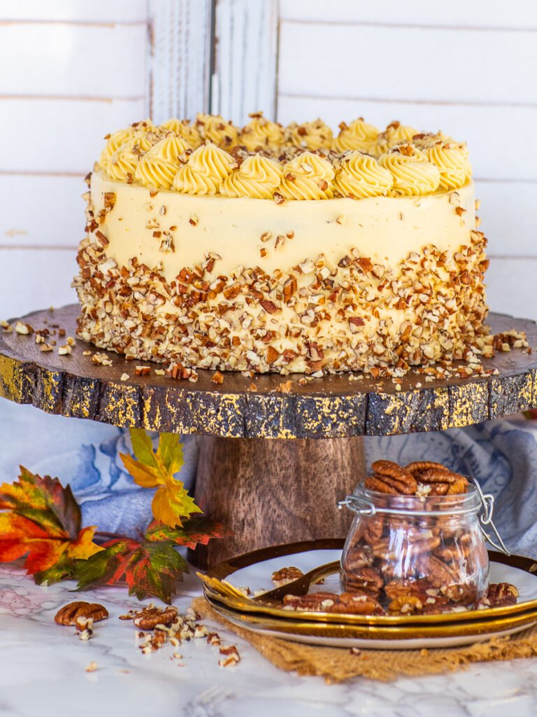 maple pecan cake with maple buttercream and diced pecans