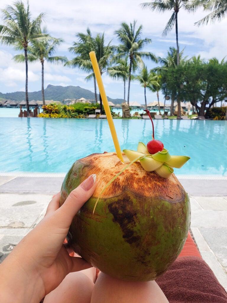 large coconut cocktail poolside