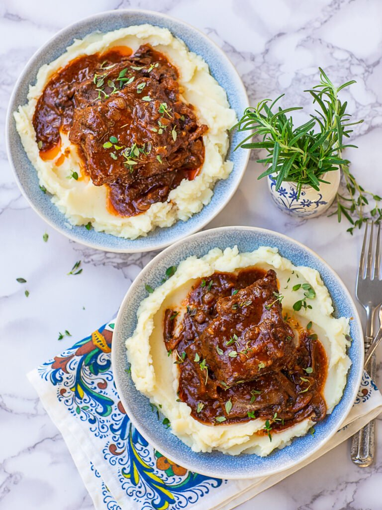 braised short ribs over creamy mashed potatoes with thyme
