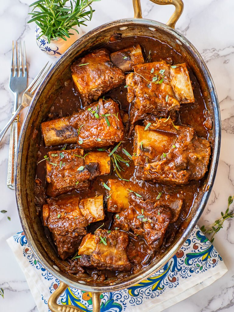 braised beef short ribs in red wine sauce with tomato paste