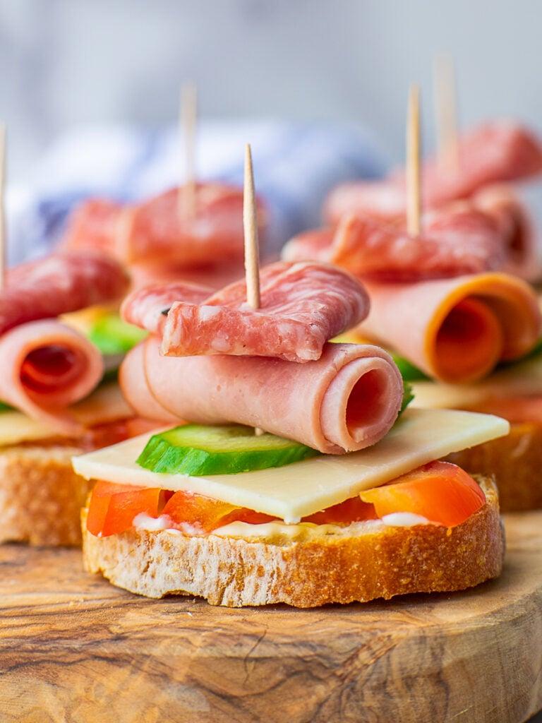 club tea sandwich with cheese, ham, salami, tomato and cucumber