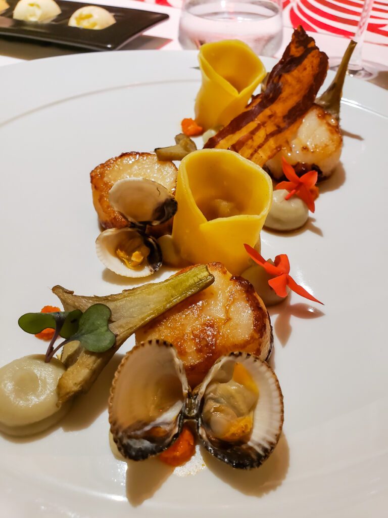 sea scallops with clams and ravioli