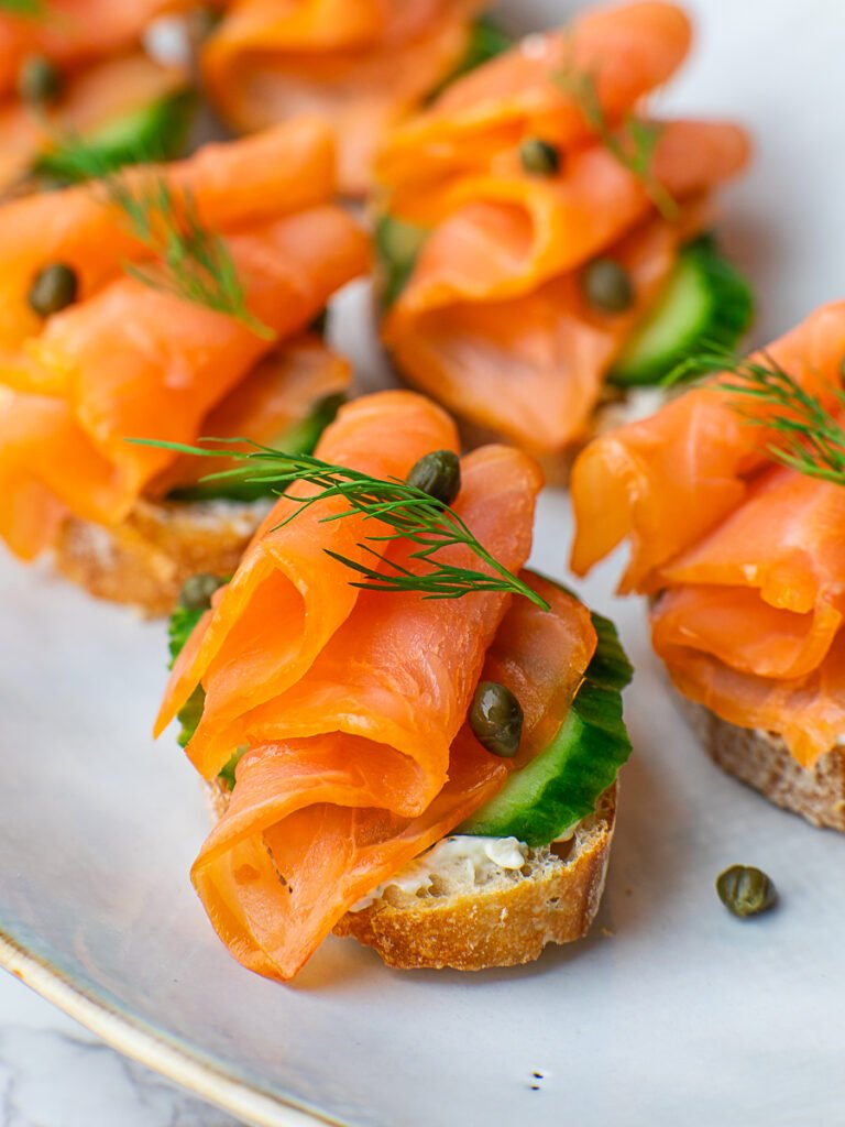 smoked salmon tea sandwich with cheese and capers