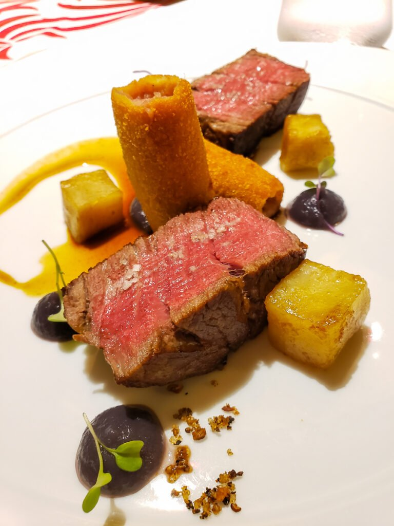 filet mignon with potatoes and garnishes at Corail Intercontinental