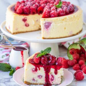 slice of raspberry cheesecake with raspberry sauce