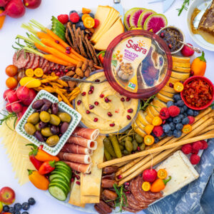 ultimate hummus charcuterie board with veggies and cheese
