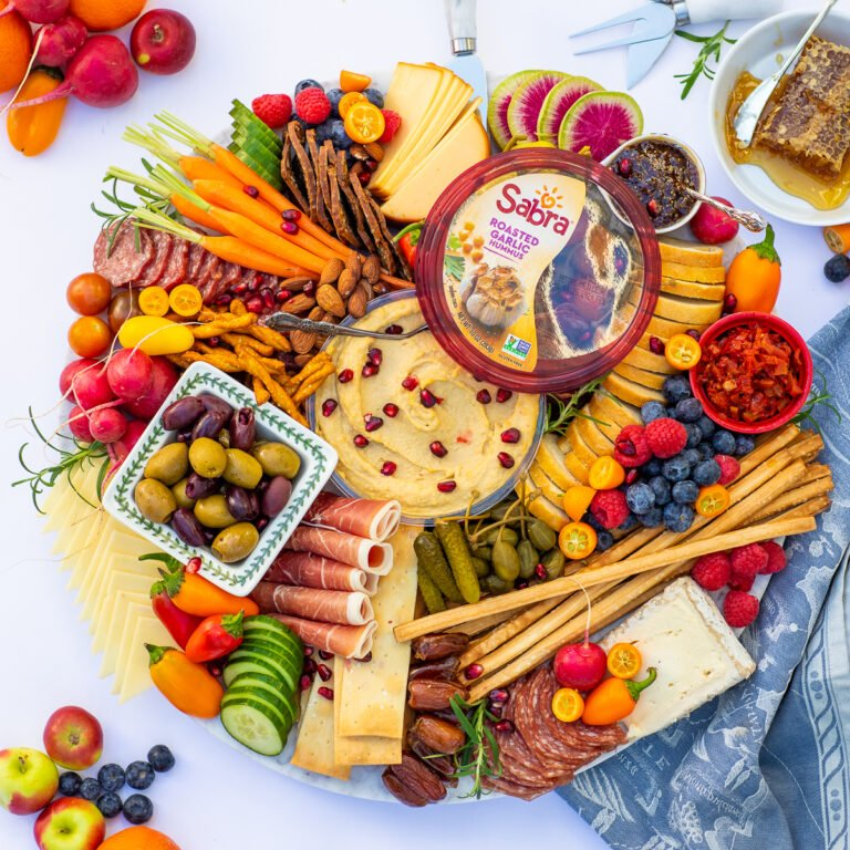 Sabra hummus charcuterie board with veggies, berries, cheese and meats