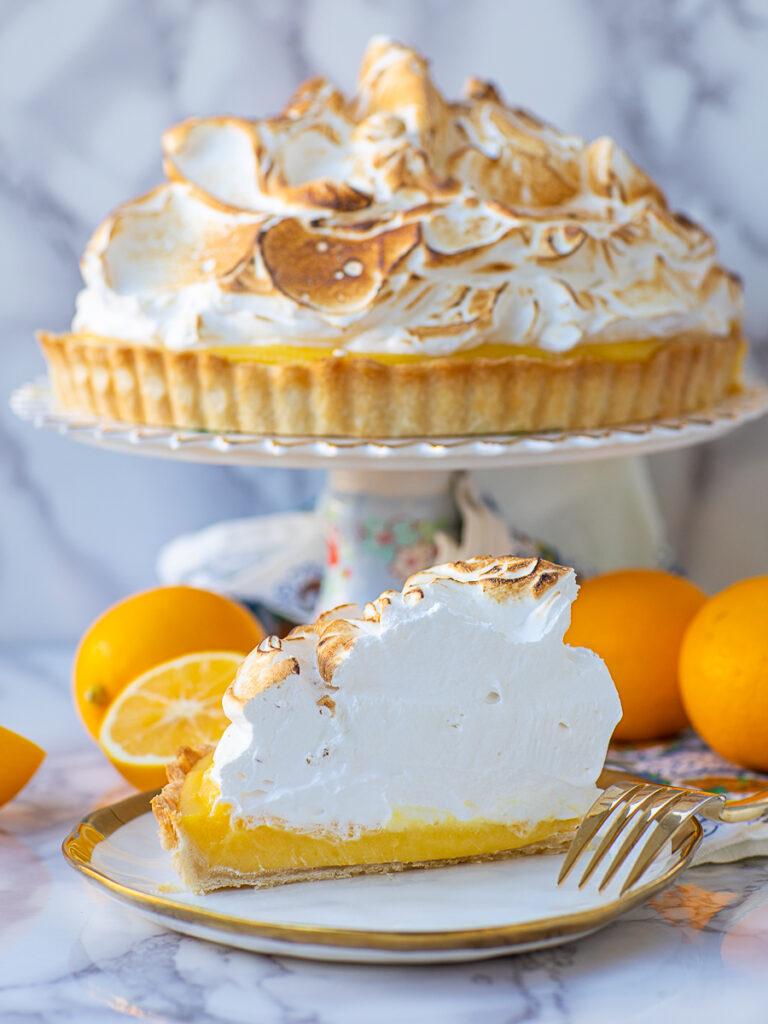 slice of lemon pie with meringue topping and butter crust