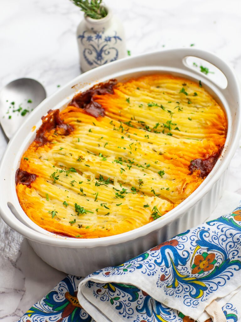 classic shepherd's pie with mashed potatoes in white casserole