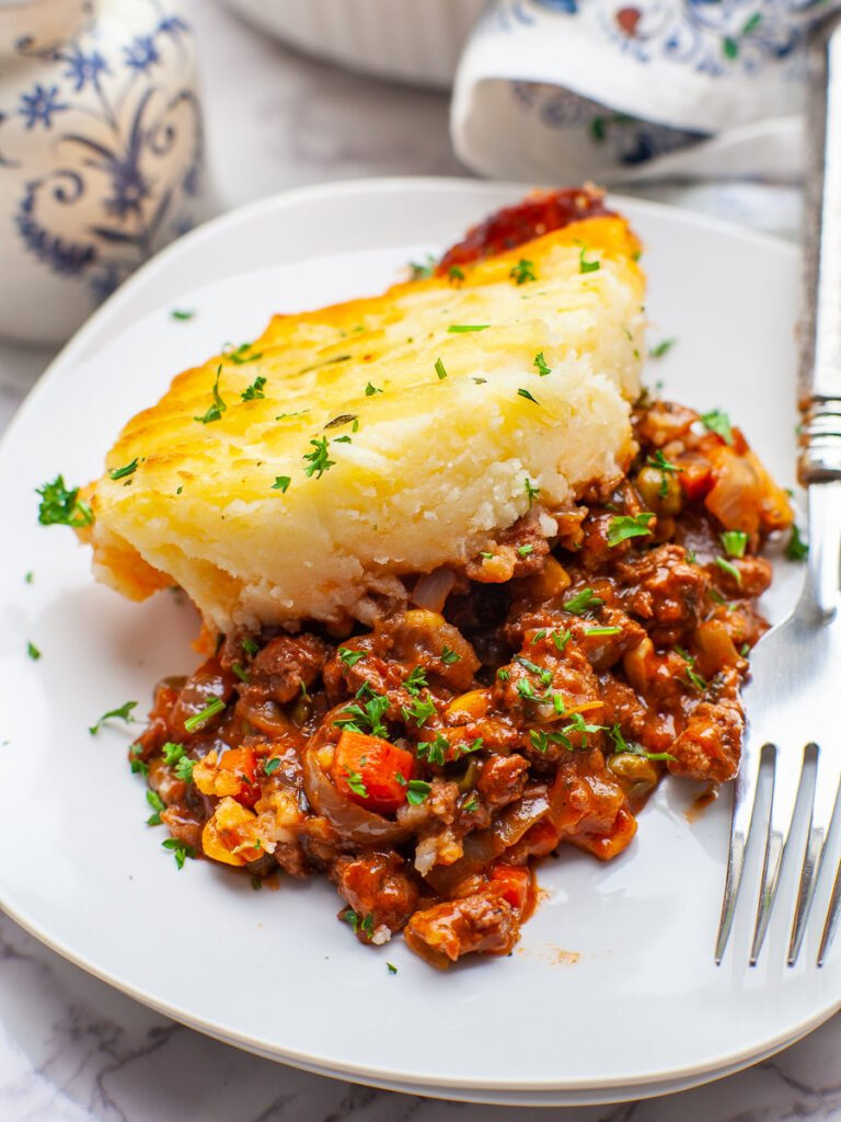 close up of shepherd's pie filling with mashed potatoes