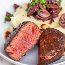 medium rare filet mignon steak with mushrooms and potatoes