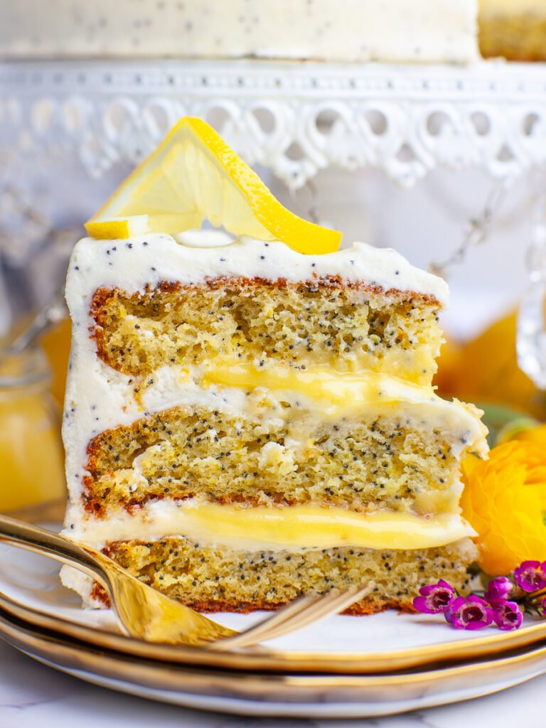 close up of sliced lemon poppy seed cake with lemon curd filling