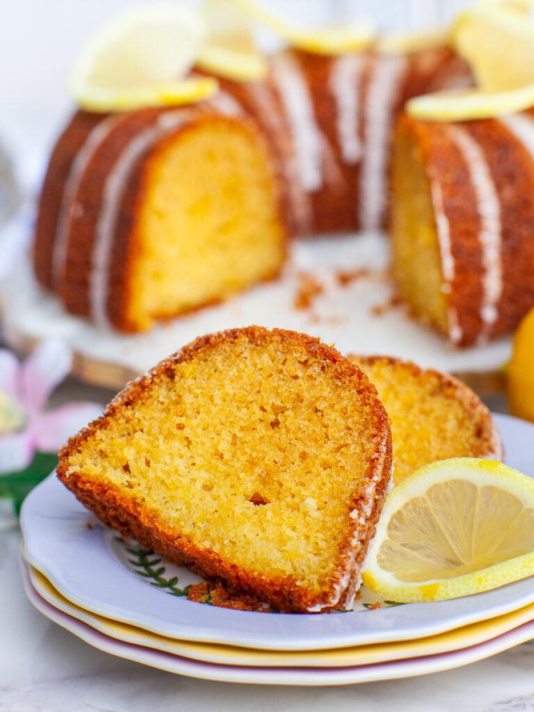 close up of lemon pound cake slice with lemon wedges