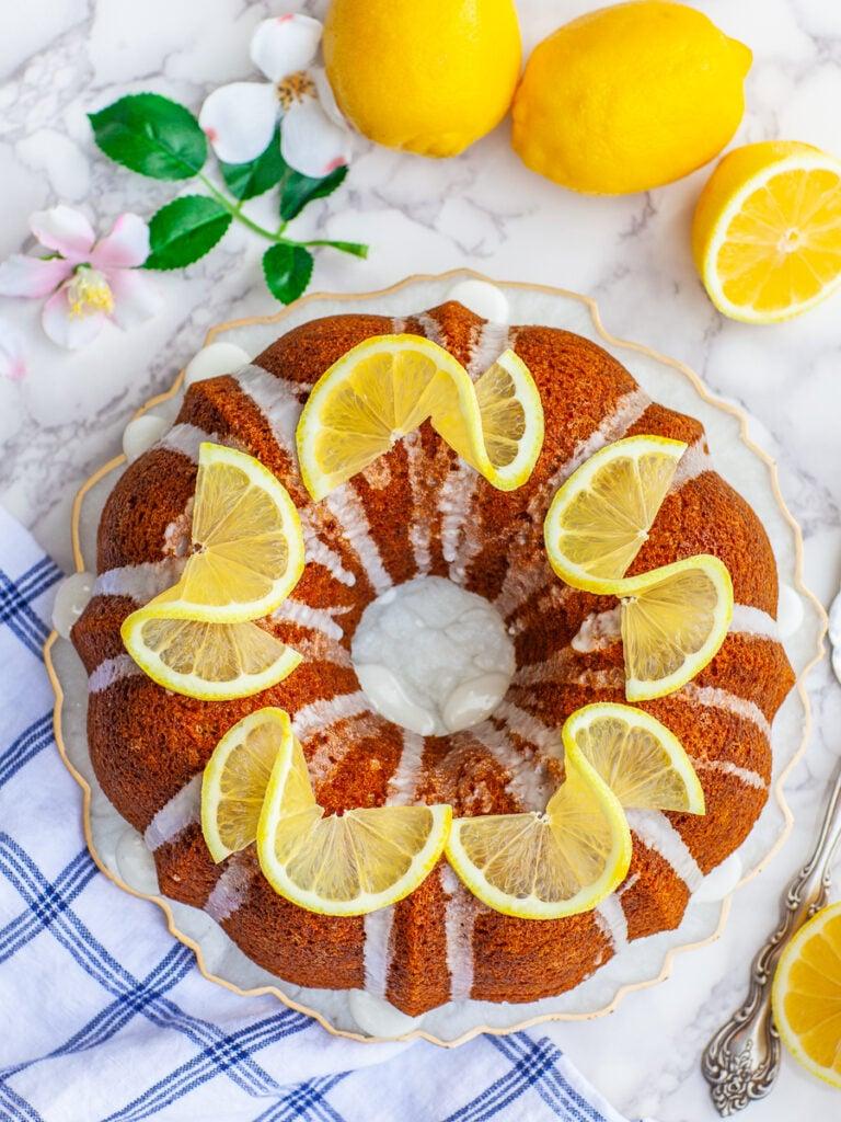 bundt lemon pound cake garnished with lemon wedges