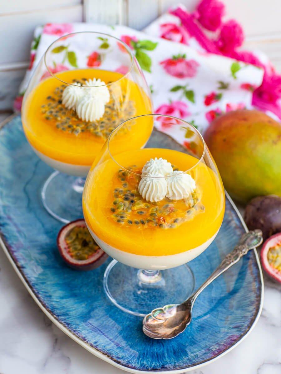 mango vanilla panna cotta in brandy cups with passion fruit